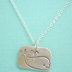 silver whale necklace.
