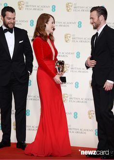 Julianne Moore (C), winner of the Leading Actress award for 'Still Alice', poses with presenters Henry Cavill (L) and Chris Evans in the winners room at the EE British Academy Film Awards at The Royal Opera House on February 8, 2015 in London, England. (Photo by David M. Benett/Getty Images)