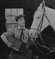 One of Buster's memorable animal scenes - selling shoes to a horse - The Blacksmith 1922