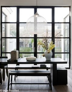 """Firm Believer: At Home in Breda with the cofounder of Moooi"" article from Elle Decor magazine. Beautiful dining space with floor to ceiling windows gives an amazing view of the garden. Light fixture is airy, yet sculptural. House Design, Decor, Interior Design, House Interior, Elle Decor, Home, Interior, Contemporary Design, Home Decor"