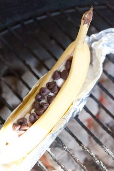 So simple to make! Chocolate and Marshmallow Stuffed BBQ Bananas  Cut open banana, fill with chocolate and marshmallows, wrap in foil.  Place on grill. Done! Perfect for your Summer Party! #designsponge #dssummerparty