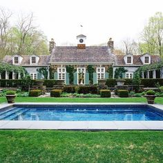 Pinterest perfection  Rebecca #shutters #symmetry #pool #hedges #ivory #topiary