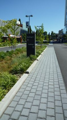 The redesign of N Gantenbein Avenue incorporates a large median with a central bioretention swale and 5,500 sf of previous pavers.