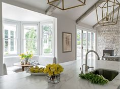 With vaulted ceilings, marble surfaces and crisp white cabinetry, this contemporary kitchen remodeled by Julie Bradshaw seems light and airy. Wood floors and nature-inspired prints add a rustic touch to the space. Breakfast Nook Decor, Kitchen Breakfast Nooks, Kitchen Nook, New Kitchen, Kitchen Dining, Kitchen Decor, Kitchen Ideas, Kitchen Pictures, Eat Breakfast