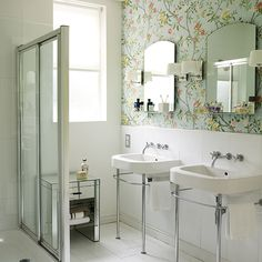 Shower room with double sinks, floral wallpaper, white flooring and walk-in shower