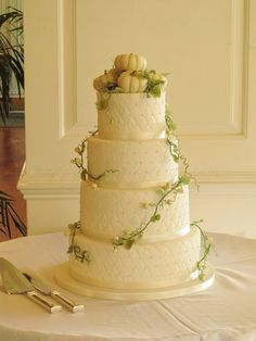 Pinner:  Love this cake!! Bride and groom fashioned like our pumpkin patch picture!
