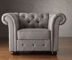 Add graceful seating to your home with this chesterfield light gray tufted linen rolled arm chair. Showcasing tufted back and rolled arms in gray linen, along with bun feet finished in dark brown, this elegant padded seat chair can provide plenty of support and comfort in style. This is great for modern, contemporary, or transitional inspired home decor.