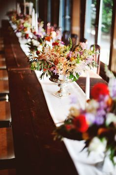 centerpieces in sterling silver - photo by Feather Love Events http://ruffledblog.com/southern-plantation-wedding-in-charleston #tablescape #weddingcenterpieces #receptions