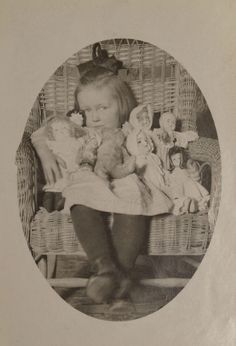 Vintage photo, girl with dolls