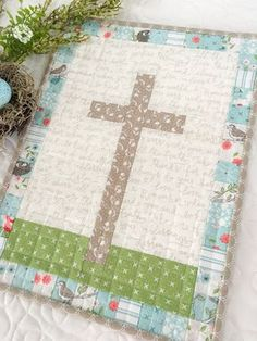 Carried Away Quilting's free pattern: He Is Risen mini quilt for Easter. Features the Nest collection by Lella Boutique for Moda.