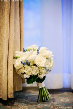 Bridal Bouquet:  white roses, white hydrangea, grape hyacinth- cream or navy wrap