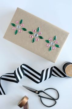 Add some color and pretty patterns to your gift wrap with self adhesive rhinestones!