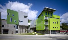 This building represents emphasis. The green building uses color to stand out from the gray surroundings.