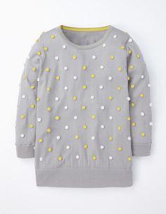 Pullover mit Pompons
