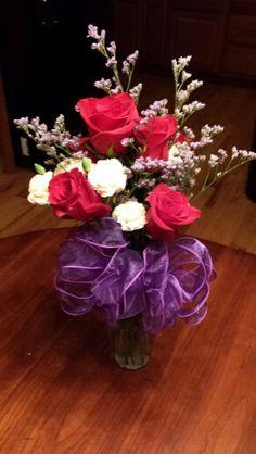 Beginner at flower arrangements.  My first bow I made also. Love making arrangements!