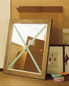 Masking Tape On Mirrors Use masking tape to place a large X on your mirrors and glass frames. It won't prevent it from breaking, but it will absorb shock and keep the glass in the frame in the case that it is dropped or shuffled in the moving truck.