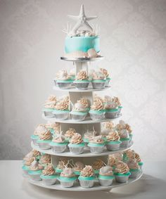 Beach Themed Wedding Cake And Cupcakes Stacked - wedding cake and cupcake tower for a beach destination Beach Theme Cupcakes, Wedding Cakes With Cupcakes, Beach Wedding Decorations, Themed Cupcakes, Beach Wedding Cupcakes, Beach Themed Wedding Cakes, Wedding Beach, Seashell Wedding Cakes, Cake For Wedding