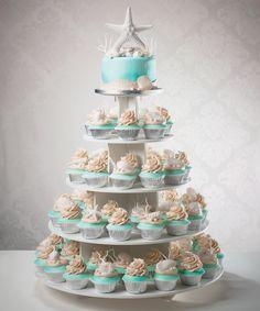 Wedding cake and cupcake tower for a beach destination wedding