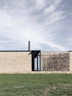 The house sits firmly along a winding ridgeline on the outskirts of the small township of Fish Creek. The home surrounds itself in a highly textured brickwor...