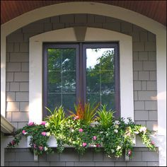 A lush display of artificial outdoor hanging azalea bushes and artificial grass creates a good mixture in this window box. Plants For Planters, Porch Plants, Fake Plants, Outdoor Planters, Outdoor Gardens, Hanging Planters, Window Box Plants, Window Box Flowers, Window Planter Boxes