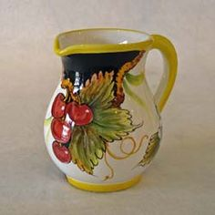 """This majolica cream pitcher from Gialletti Giulio in Deruta is 4.5"""" Hi.  It is handpainted in the Black Frutta design with cherries and sunflowers. http://www.theclaycorner.com/"""