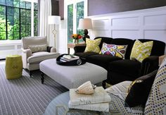 living rooms - Suzanne Kasler Quatrefoil Floor Lamp French Key End Table chocolate brown grasscloth wallpaper yellow ikat pillows chocolate brown double gourd lamps yellow garden stool gray Greek key rug ivory chair black piping black faux croc tray