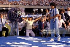 Diego Armando Maradona, new purchase of Napoli Calcio, is presented at Stadio San Paolo in front of eighty thousand fans of the Naples Calcio on July 5, 1984 in Naples, Italy.