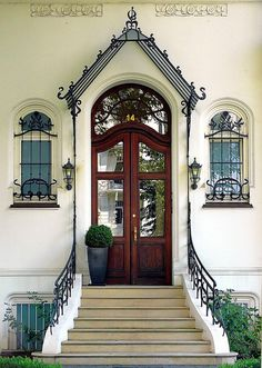 Beautiful Door and Windows in Hamburg, Germany.  Love ALL the ornate ironwork, but especially on the roof of the portico!!