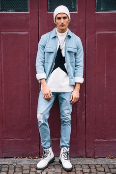 Double denim look accompanied with mens white doc marten boots, knit jumper and finished with a thin knit white beanie both from Topman