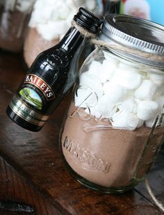 3 edible DIY gifts in a jar, including grown up hot chocolate! Yields about 6 jars. Ingredients: 10-12 packets of hot cocoa, 3 cups of mini-marshmallows, 6 bottles of mini Baileys, festive ribbon or twine, 6 pint size mason jars, plus candy canes, white chocolate or regular chocolate chips for garnish.