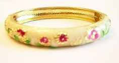 Floral Pattern White Cloisonné Bangle Bracelet Oriental Treasures. $12.00. Fashion tip: combine one or more of different styles for a personalized look.. Handcrafted with enamel.. Floral Pattern White Cloisonné Bangle Bracelet. Bracelet has spring action closure and width is 10 mm.. Diameter:  2 ½ inches.