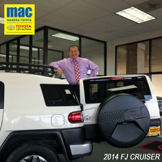 Our General Sales Manager climbs onto the 2014 FJ Cruiser at Madera Toyota.