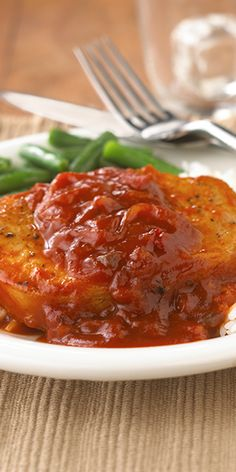 Pork chop recipe for boneless pork chops simmered in Sloppy Joe sauce sweetened with apricot preserves