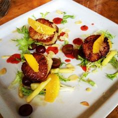 Seared scallops, oranges, grapes, pineapples with toasted almonds & a tropical fruit mint sauce