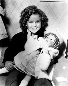 Shirley Temple and her Shirley Temple doll, 1936.