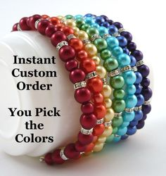 "7 Pearl and Rhinestone Bridesmaids Bracelets - Instant Custom Order - Bracelets in Your Choice of Colors - ""Original"" Style by PineberryBoutique on Etsy https://www.etsy.com/listing/180002862/7-pearl-and-rhinestone-bridesmaids"