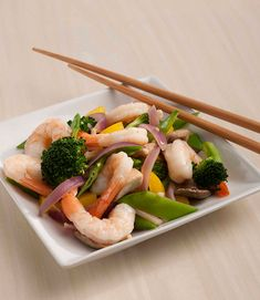 This fresh and tasty shrimp stir-fry is packed with colorful veggies. Serve with ½ cup cooked brown rice if desired. #seafood #shellfish #shrimp #vegetables #stirfry
