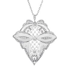 An incredible estate pendant, handmade with meticulous attention to symmetry. Crafted in platinum, the pendant measures 2 3/4 inches long by 2 1/2 inches wide. Though large, the pendant remains delicate by the utilization of hand piercing throughout its finely detailed aesthetic. c 1915