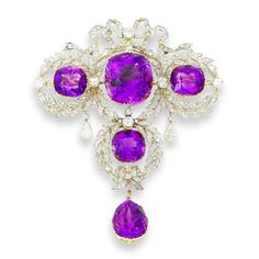 A belle époque amethyst and diamond corsage ornament, circa 1900  In the garland style, set with four large cushion-shaped amethysts in cross formation, the largest to the centre, within a delicate openwork foliate and fluttering ribbon bow surround of single-cut diamonds, interspersed with larger old brilliant-cut diamonds and pear-shaped diamond drops, terminating in a pear-shaped amethyst, detachable brooch and pendant fittings, length 10.0cm., fitted case