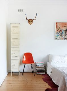 Spare white bedroom | The Design Files. Like how low the bed is to the floor.