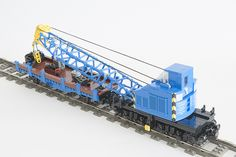 Widely used in Central and Eastern Europe 20t railway crane. Everyone know how a train crane should look like. It is to be blue. Here it comes :) My 7-8 wide version of a very characteristic medium-size crane as a part of maintenance equipment on the train diorama. Designed rather for standing on a side track, but still built to run on tight LEGO track curves and points. This required some compromises on the base of the crane itself but who cares. The crane arm is controlled by two winch...