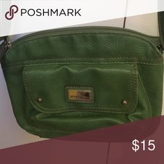 A small green bag Inside has cheatah/jaguar print and it has pockets inside Jaclyn Smith Bags Shoulder Bags