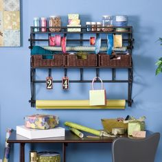 For the organizational and craft enthusiast in your life, gift this Wall Mount Craft Storage Rack with Baskets. With three rattan baskets, two racks, and five hooks, there is plenty of space for all desk or craft room accessories.