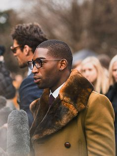 British musician Tinie Tempah wearing Burberry outerwear as he arrives for the Burberry Menswear A/W14 show