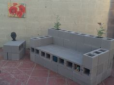 Cinderblock couch - Not done, but the backyard is getting there! DIY backyard furniture and planter.