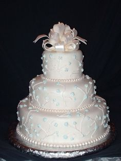Mmf Bow And Pearls A practice run of the wedding cake I will make for my sister in a few weeks. It's covered in MMF with a MMF bow and. Victorian Wedding Cakes, Whimsical Wedding Cakes, Beautiful Wedding Cakes, Beautiful Cakes, Fondant Bow, Fondant Cakes, Cupcake Cakes, Cake Decorating Techniques, Cake Decorating Tutorials