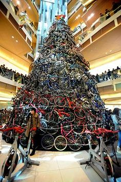 a 12 meters tall christmas tree decorated with 230 bicycles is installed at a shopping mall
