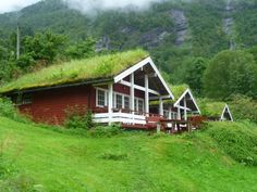 Grass-roofed homes in Geirangerfjord, Norway. Given the importance of sustainable practices today and the contemporary interest in roof garden projects (for schools, residences and municipal projects) where grasses, herbs and cultivated flowers can be grown, it is fascinating to note this Scandinavian practice. When the grass grows too dense, goats are sent onto the roof to crop the abundance of growth. Images are copyright Lorella Brocklesby