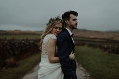 A wedding at Crear on the West Coast of Scotland, featuring moss and antlers and a Midsummer Nights Dream style bride in her Rowanjoy dress and floral circlet by Myrtle & Bracken Florists.  Images by Kitchener Photography.