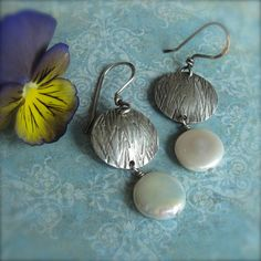 Hey, I found this really awesome Etsy listing at http://www.etsy.com/listing/69395208/simple-earrings-w-ivory-coin-pearls